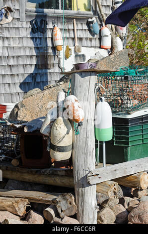 Fishing gear, inc. lobster pots and traps, on the deck of the Otter Creek Aid Society fish house, Otter Cove, Mt. - Stock Photo
