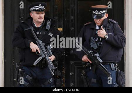London, UK. 16th Nov, 2015. Armed police officers patrol outside the Embassy of France in London, UK, Monday, November - Stock Photo