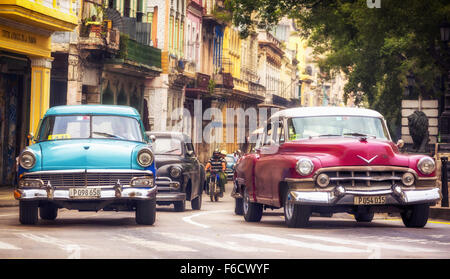 Oldtimer in the streets, old American road cruiser on the streets of Havana, Taxi, La Habana, Havana, pink car, - Stock Photo