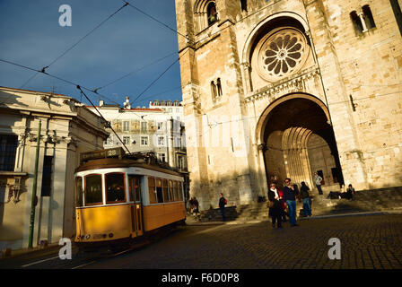Old tram in front of Se Cathedral in Lisbon, Portugal. Europe - Stock Photo