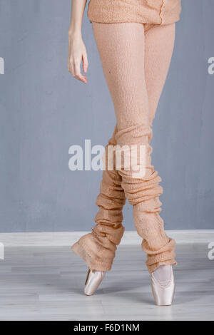 Slender legs of a ballerina in pointe closeup. Ballerina in training. The dancer is rehearsing. The concept of classic - Stock Photo