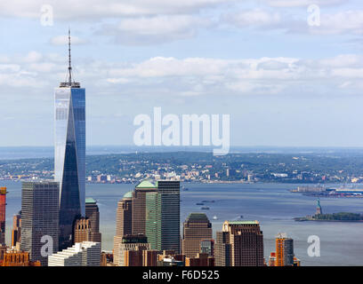 NEW YORK, NY - JULY 10, 2015: View of the Freedom Tower with on the background Upper Bay and Statue of Liberty, - Stock Photo