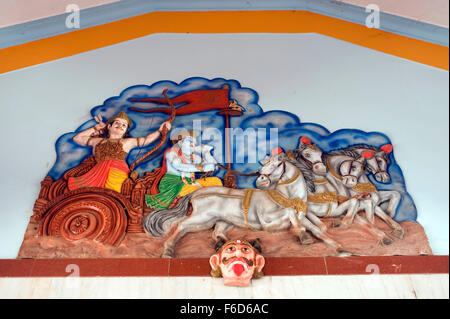 Arjuna with krishna on chariot relief figures, shri ravalnath temple, goa, india, asia - Stock Photo