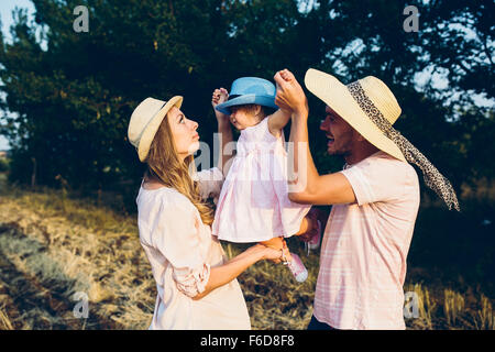 Parents and kid spending time - Stock Photo