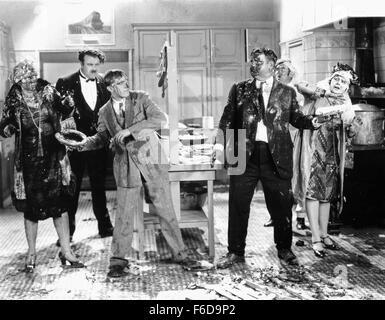 Jan. 1, 1920 - Kay Deslys, Tiny Sandford, Stan Laurel, Oliver Hardy and Anita Garvin on-set of the Film, Their Purple - Stock Photo