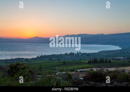Sunset over the Sea of Galilee from Ramot, Golan Heights, Israel, MIddle East. - Stock Photo