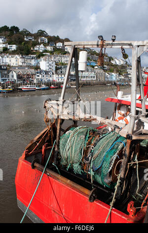 A fishing trawler berthed alongside the harbour wall at east looe in Cornwall, waits for the tide to turn. - Stock Photo