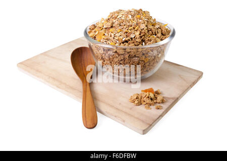 Granola cereal with dried fruits and wooden spoon isolated on white background - Stock Photo