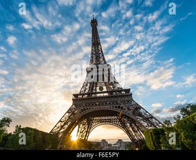Sunset behind Eiffel Tower, Champ de Mars, Paris, Ile-de-France, France - Stock Photo