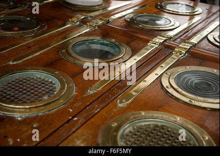 brass portholes and access doors on the deck of RRS Discovery Royal Research Ship moored at Discovery Point Dundee - Stock Photo