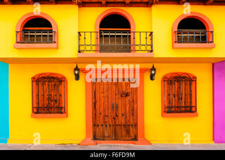 Exterior of Mexican house with wooden door and windows, Puerto Vallarta, Mexico - Stock Photo