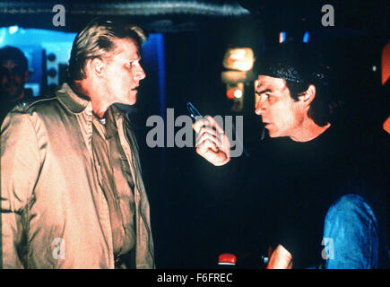 Oct 09, 1992; Hollywood, CA, USA; TOMMY LEE JONES as William Stranix and GARY BUSEY as Cmdr. Krill in the action, - Stock Photo