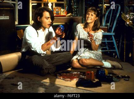 Apr 16, 1993; Spokane, WA, USA; JOHNNY DEPP as Sam and MARY STUART MASTERSON as Juniper 'Joon' Pearl in the comic, - Stock Photo