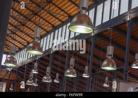 modern lights hanging from an old wooden roof - Stock Photo
