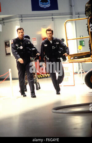Feb 09, 1996; Hollywood, CA, USA; JOHN TRAVOLTA (left) as Maj. Vic Deakins and CHRISTIAN SLATER as Capt. Riley Hale - Stock Photo