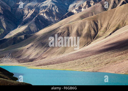 Chandra Taal lake near Kunzum Pass between Spiti and Lahaul valley, Himachal Pradesh, Northern India - Stock Photo