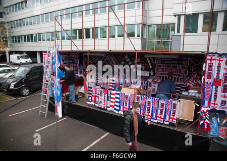 Wembley London, UK. 17th Nov 2015. Vendors prepare the stall to sell memorabilia and scarfes ahead of the friendly - Stock Photo