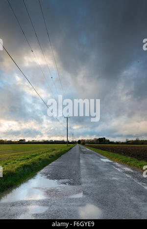 Cambridgeshire Fens, UK. 17th Nov 2015. Storm Barney fills the wide open skies of the Cambridgeshire Fens at Over, UK. As the weather system arrived in East Anglia clouds moved quickly across the sky and the wind began to whip up in the open landscape.  The wind is due to pick up during this evening and overnight as the storm continues to move eastwards over the UK. Credit Julian Eales/Alamy Live News