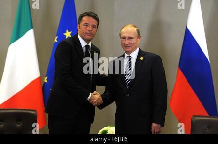 Russian President Vladimir Putin and Italian Prime Minister Matteo Renzi meet on the sidelines of the G20 summit - Stock Photo