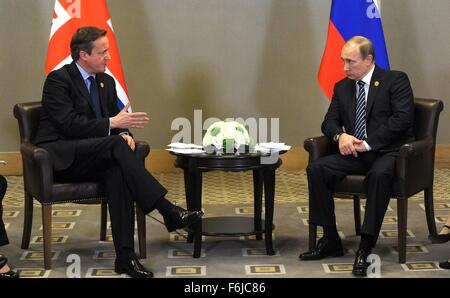 Russian President Vladimir Putin and British Prime Minister David Cameron meet on the sidelines of the G20 summit - Stock Photo