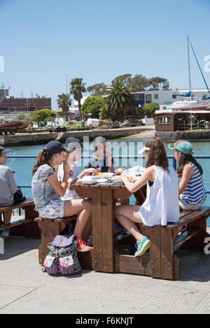Schoolchildren enjoy a fish and chip lunch during an educational visit to Simon's Town home of the South African - Stock Photo