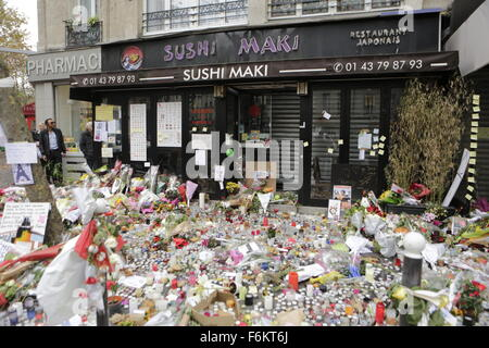 Paris, France. 17th November 2015. Floral tributes have been placed at the memorial outside the restaurant La Belle - Stock Photo