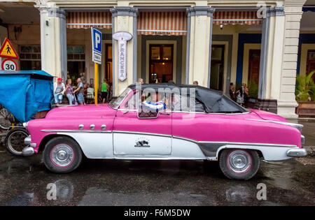 Oldtimer, convertible in the rain with closed roof, old limousines, pink, rain in Cuba, Street Scene, Cuba, North - Stock Photo