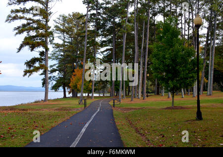 Paved walking, jogging trail through a park located in Guntersville, AL, USA - Stock Photo
