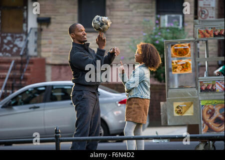 RELEASE DATE: December 19, 2014 TITLE: Annie STUDIO: Columbia Pictures DIRECTOR: Will Gluck PLOT: Business tycoon - Stock Photo