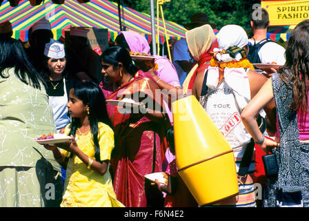 Hare Krishna Devotees gather to eat after Chariot Parade and Festival of India, Vancouver, BC, British Columbia, - Stock Photo