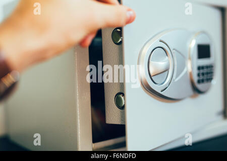 Opening of a safe where money is deposited - Stock Photo