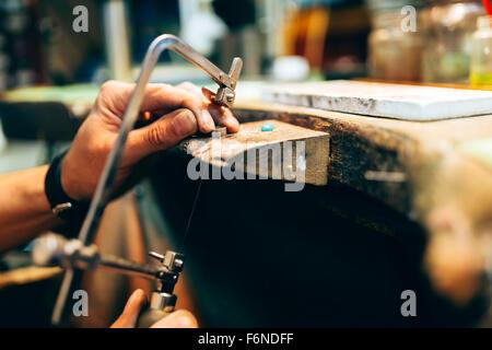 Jeweler creating jewelry - Stock Photo