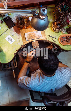 Craftsman working on his workbench with many tools - Stock Photo