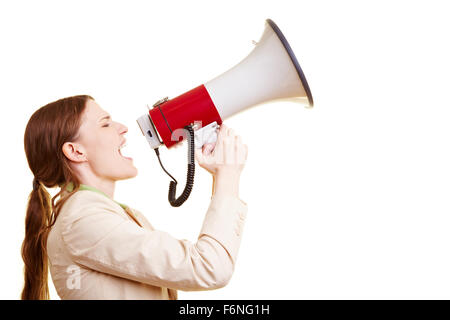 Businesswoman screaming loudly in a big megaphone - Stock Photo