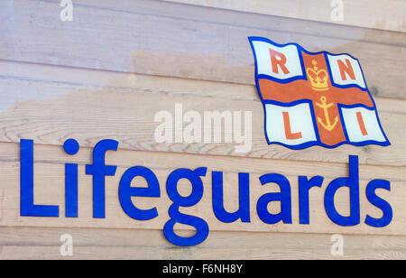 Royal National Lifeboat Institute Lifeguards Sign, UK - Stock Photo