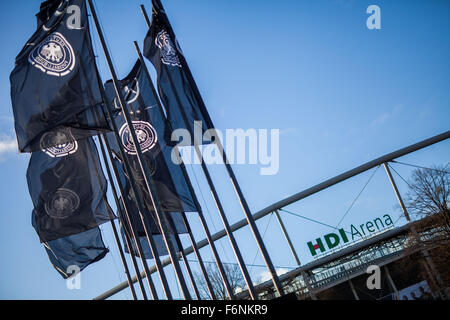 Hanover, Germany. 18th Nov, 2015. German Football Association flags wave at the HDI Arena after the cancellation - Stock Photo