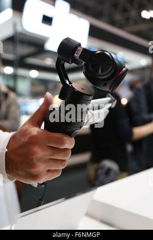 Chiba, Japan. 18th November, 2015. A man tries out the new DJI Osmo at the International Broadcast Equipment Exhibition - Stock Photo