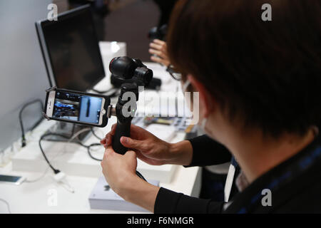 Chiba, Japan. 18th November, 2015. A man looks at the new DJI Osmo at the International Broadcast Equipment Exhibition - Stock Photo