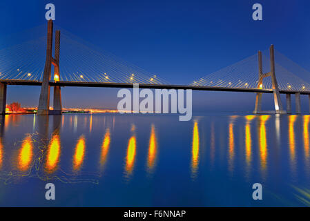 Portugal: Nocturnal view of Vasco da Gama bridge over river Tagus - Stock Photo