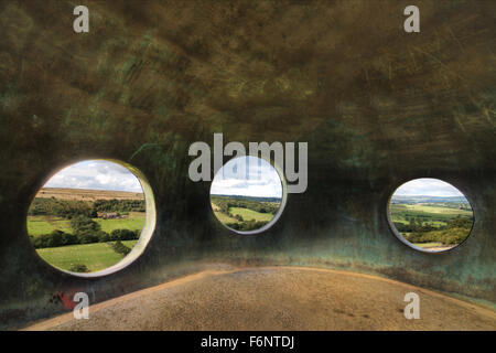 A view of the distant hills from the porthole windows of the Wycoller Atom