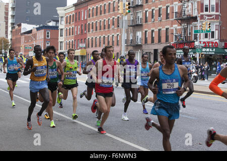 Front runners in the NYC Marathon 2015 along 4th Ave. in Brooklyn with Stanley Biwott (left) of Kenya the eventual - Stock Photo