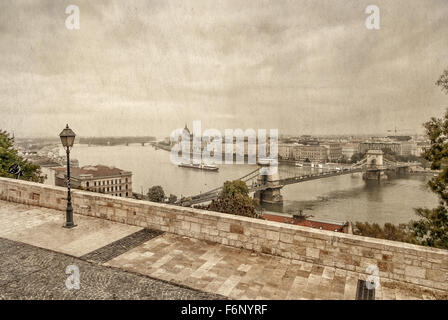 View over Danube river in Budapest with parliament building and szechenyi bridge behind taken from buda castle complex. - Stock Photo