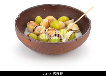 salt roasted ginkgo nuts, japanese food isolated on white background - Stock Photo
