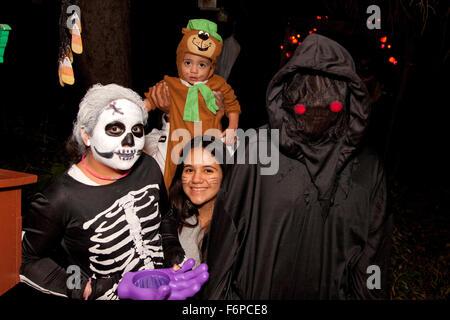Scary tricks or treating costumed skeleton cat Halloween children. St Paul Minnesota MN USA - Stock Photo