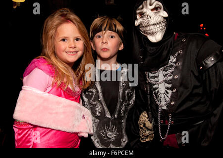 Costumed Halloween goblins out trick and treating. St Paul Minnesota MN USA - Stock Photo