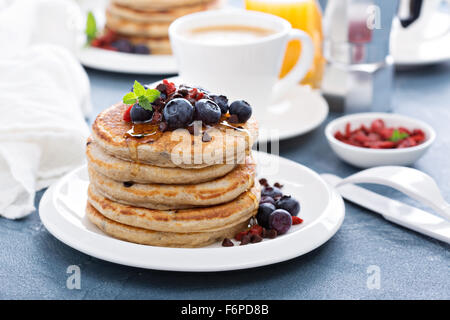 Fluffy chocolate chip pancakes on breakfast table - Stock Photo