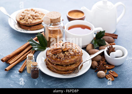 Cinnamon and spices pancakes with crumble layer and pecan nuts - Stock Photo