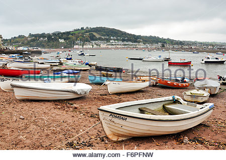 Boats on the beach at Teignmouth in Devon, with Shaldon viewed in the background - Stock Photo