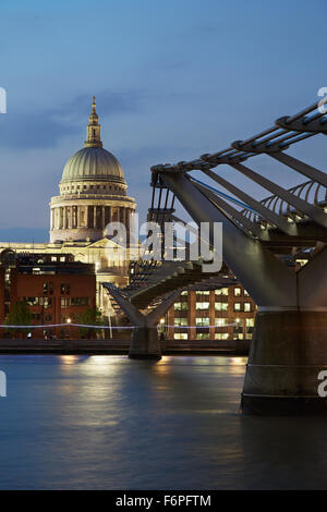 St Paul's cathedral and Millennium bridge in London in the evening - Stock Photo