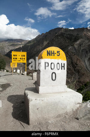 Indian road sign at Pooh in the Himalayan region of Himachal Pradesh - Stock Photo